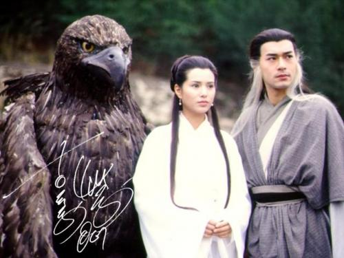 On the left is an eagle who is bigger than a human being, in the center there is a beautiful woman with long hair wearing a white dress, and on the right is a man with both black and white hair.