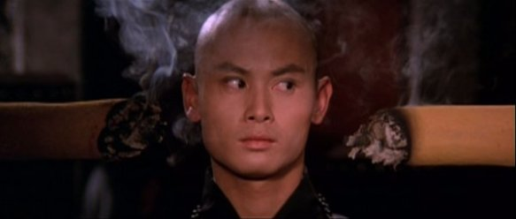 San Te's head is between two giant burning pieces of incense.