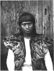 An indigenous man, possibly Rukai, wearing fur from a clouded leopard