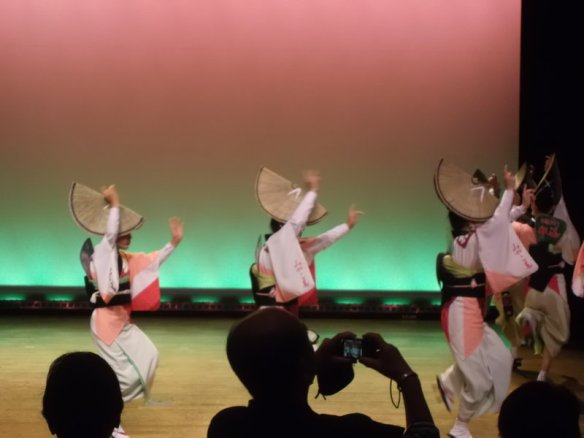 Three female dancers, dressed as the dancer in the first photo in this post, are moving from left to right in a line
