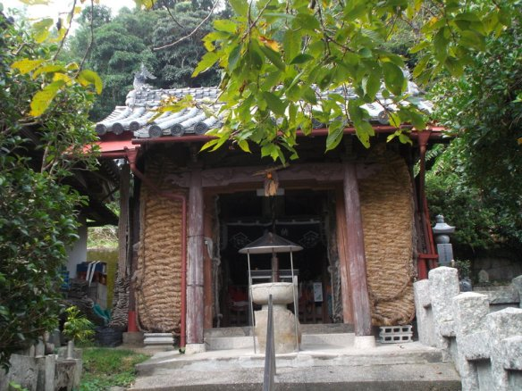 A little temple gate, with a straw sandal over 6 feet (two meters) long on each side of the entrance