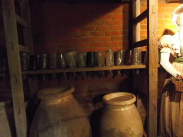 Back in the old days before refrigerators, these large jugs would be buried under the ground, with only the lips above ground. That was for storing things which could not be kept in the heat.