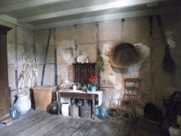 In this room you can see the original walls with cypress beams and brick. There is no bedrock here - just river silt - so they had to build brick  structures ten feet into the ground to make the building stable. By 'they' I am referring to slaves of course.