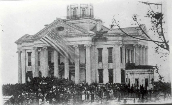 This is the courthouse during the Civil War. Obviously, this photo was taken after the Siege of VIcksburg was over.