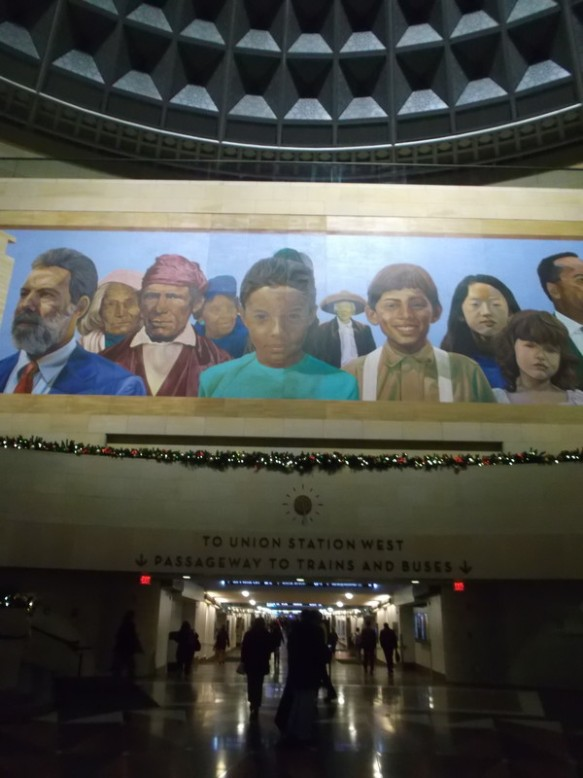 a photo of an entrance to Union Station, with a large mural above the entrance.