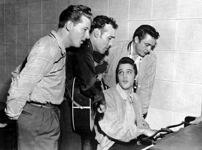 The famous photo taken of Jerry Lee Lewis, Carl Perkins, Elvis Presley, and Johnny Cash in the Sun Studio recording room.