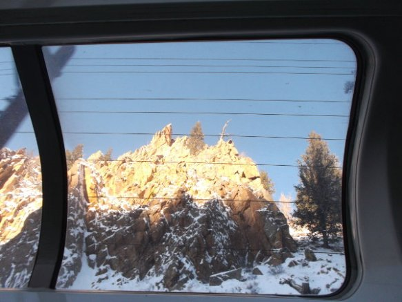 This looked much more beautiful in person. I had to point the camera upward at one of the windows in the roof of the train car because the cliffs are that high above the train tracks.